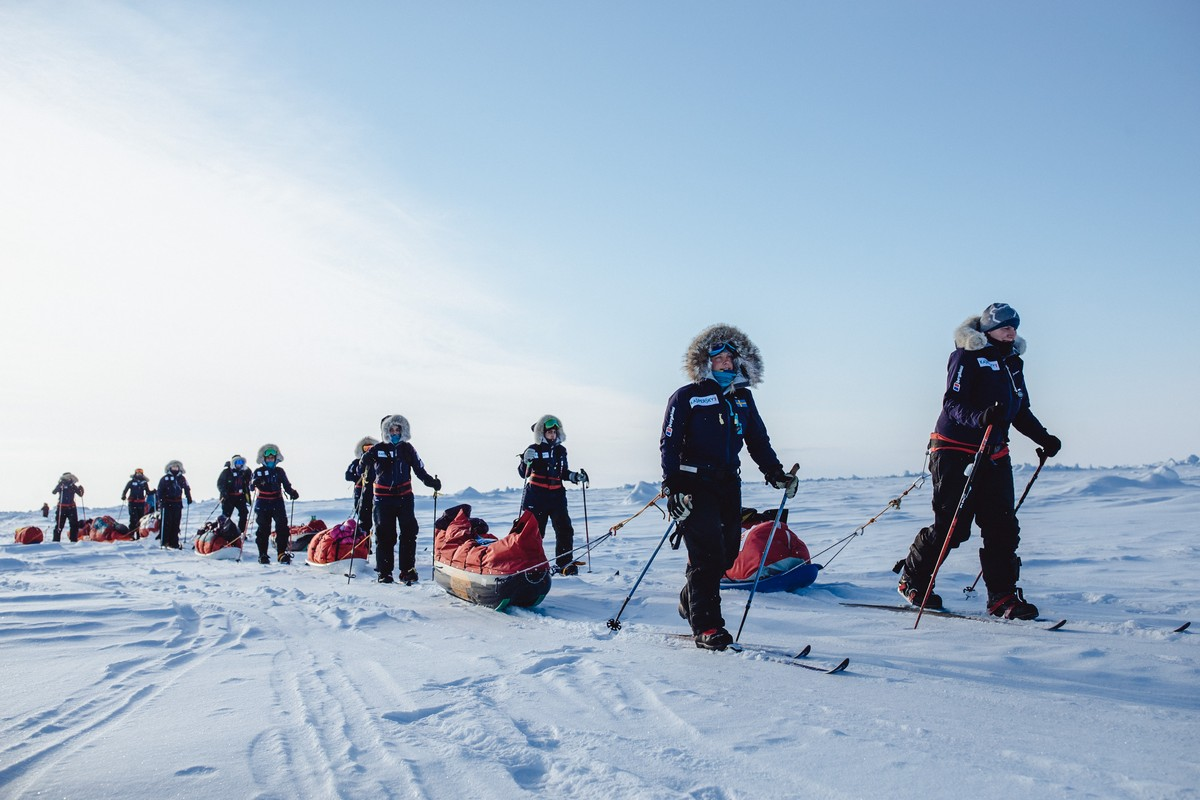 11 brave women at the North Pole.